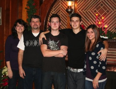 Justin (center) and his family