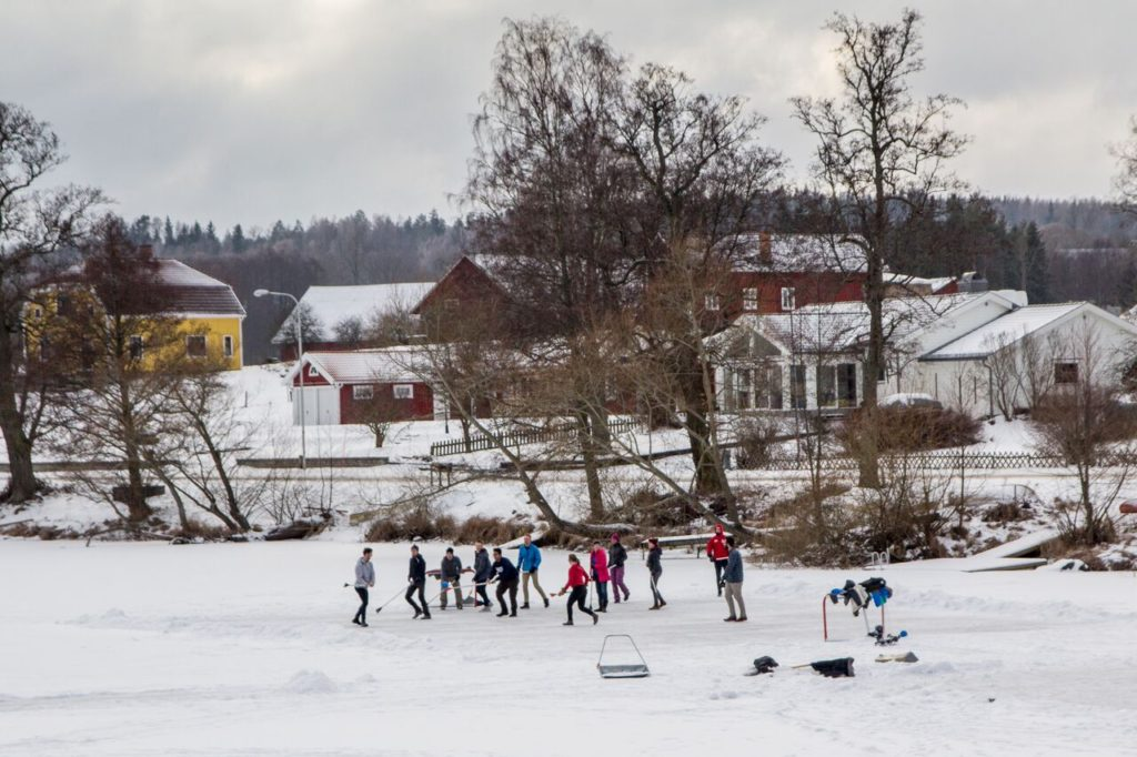 Playing broom ball on a frozen lake